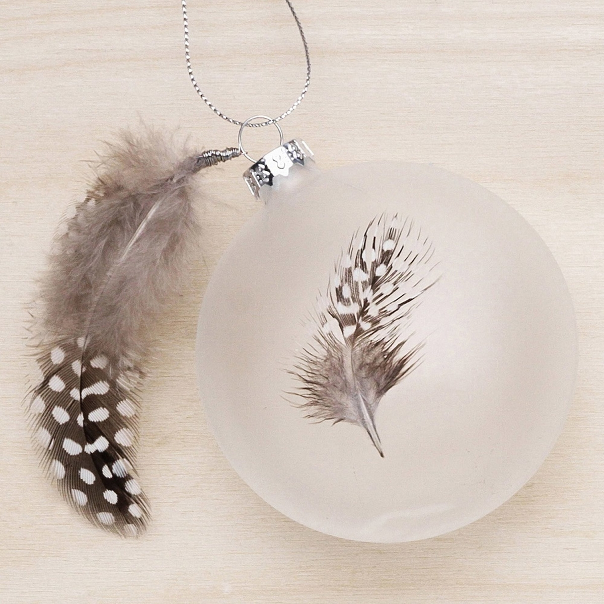 Christmas tree bauble with feathers